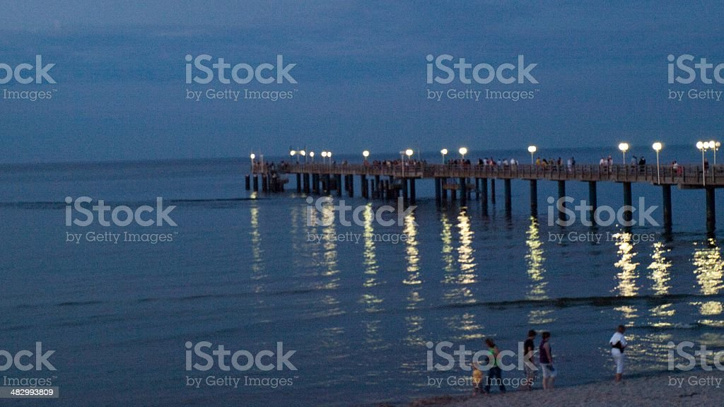the pier at dusk stock photo