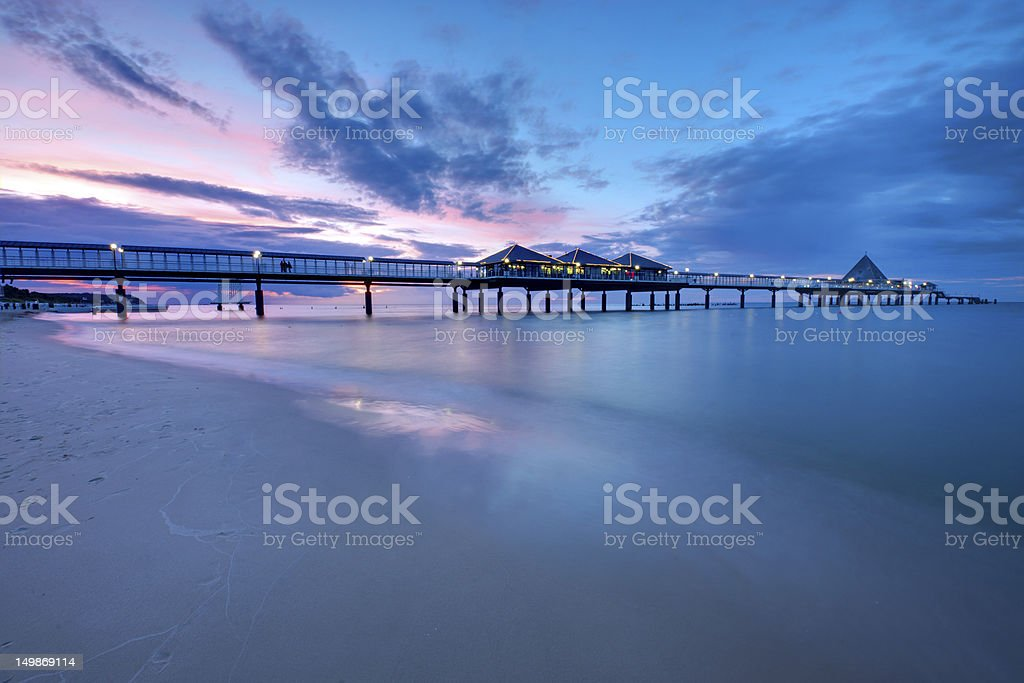 The pier of Heringsdorf at sunset stock photo
