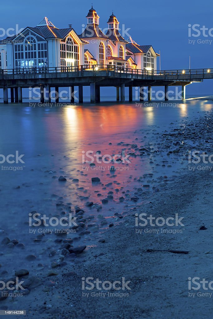 The pier of Sellin at night stock photo