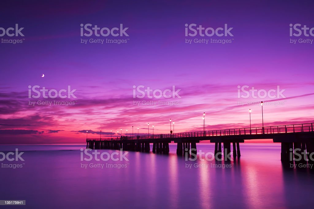 The pier with a gorgeous pink and purple sunset royalty-free stock photo