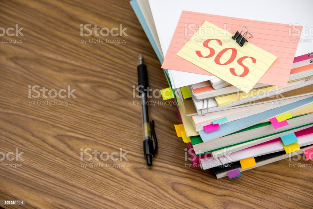 SOS; The Pile of Business Documents on the Desk stock photo