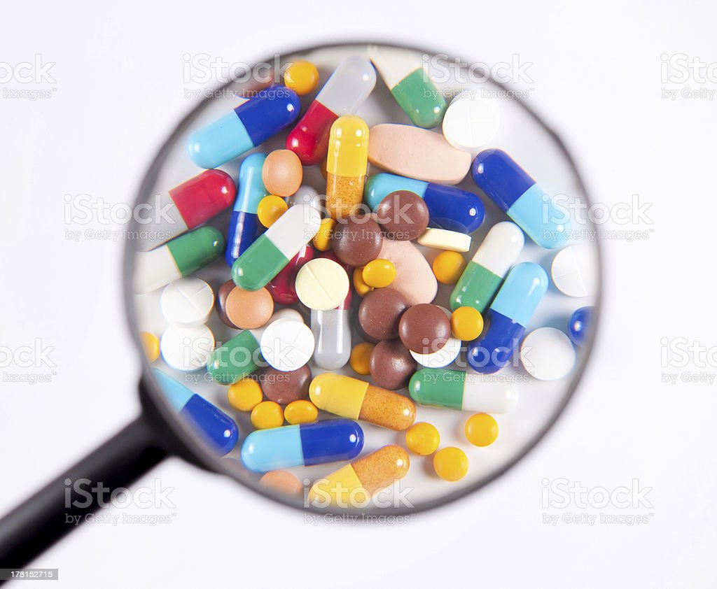 The pills under scrutiny royalty-free stock photo