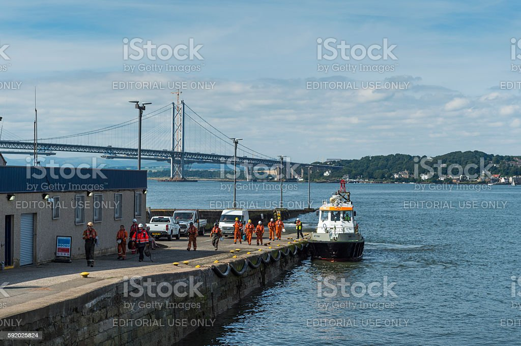 The pilot vessel Young Smit and oil workers in Scotland stock photo