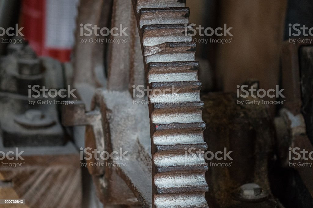 The pinion gear of an old mechanical device stock photo