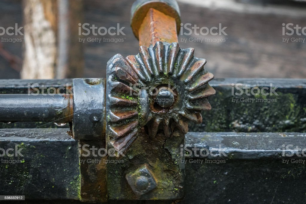 The pinion gear with wheel of an old mechanical  device stock photo