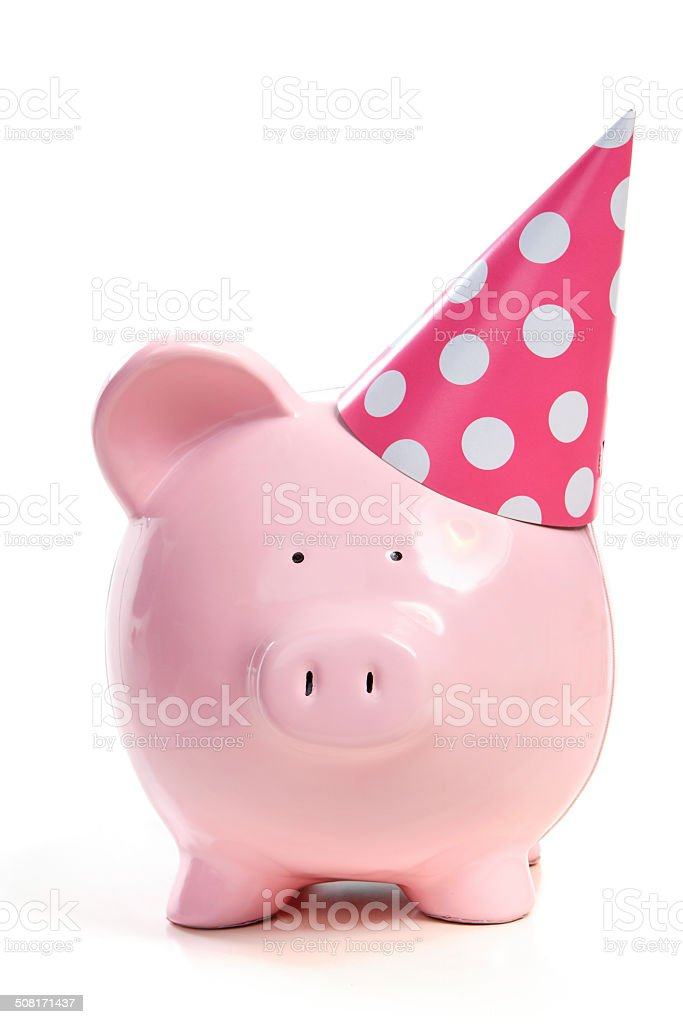 The pink  pig in a cap stock photo