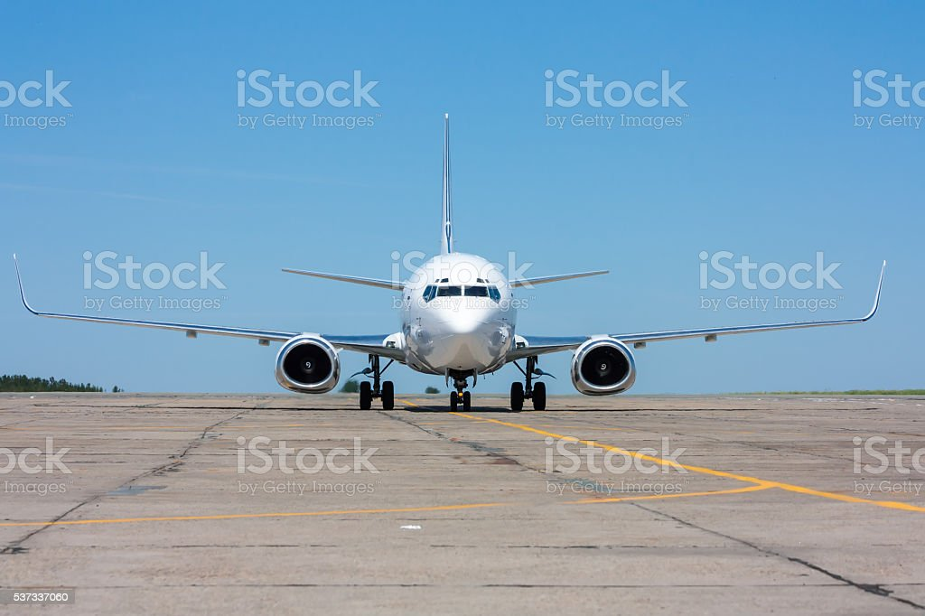 The plane moves on the taxiway in the hot summer day royalty-free stock photo