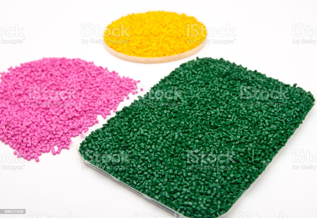 The plastic granules into a measuring container on a light table in the laboratory. stock photo