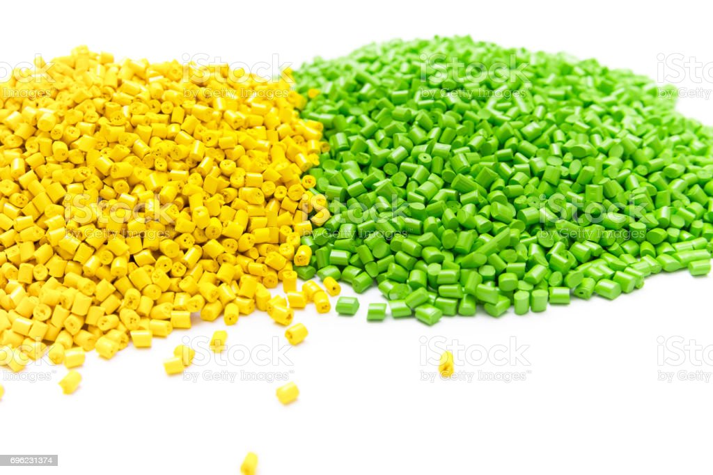 The plastic granules. Polymeric dye on a light table in the laboratory. stock photo
