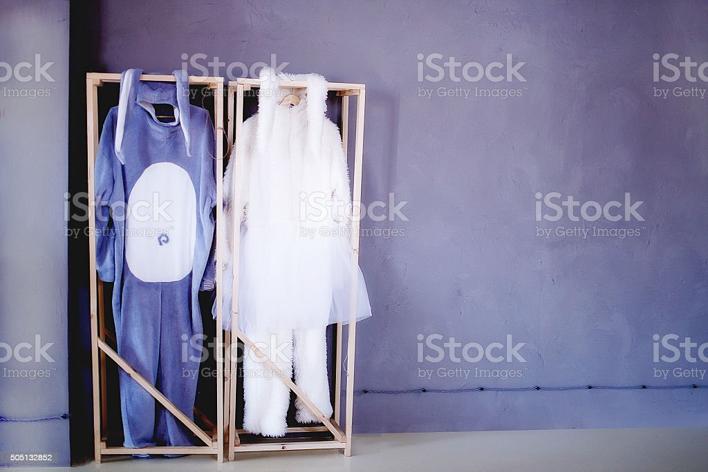 the play is over. costumes rabbits on a hanger stock photo