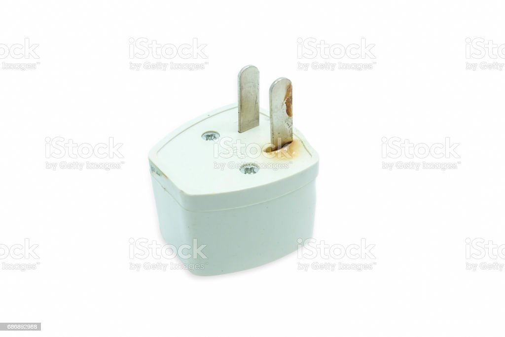 The plug is damaged by a short circuit, isolated on a white background stock photo
