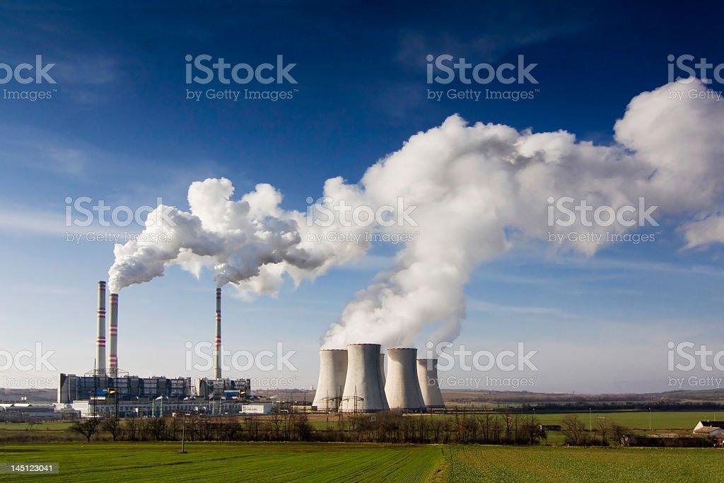 The Pocerady power station sending smoke stock photo