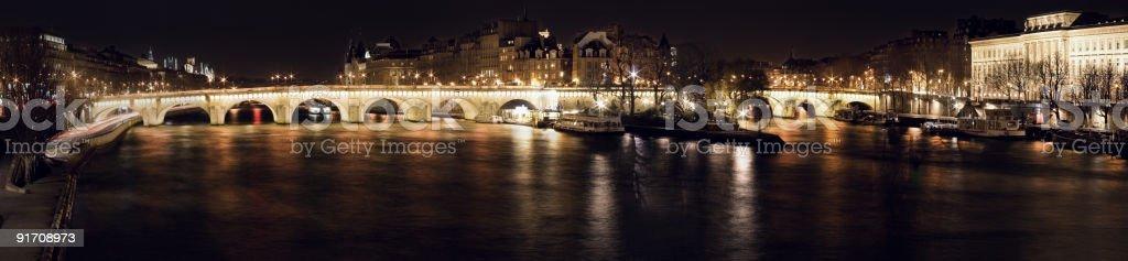 The Pont-Neuf bridge by night in Paris, France, panorama royalty-free stock photo