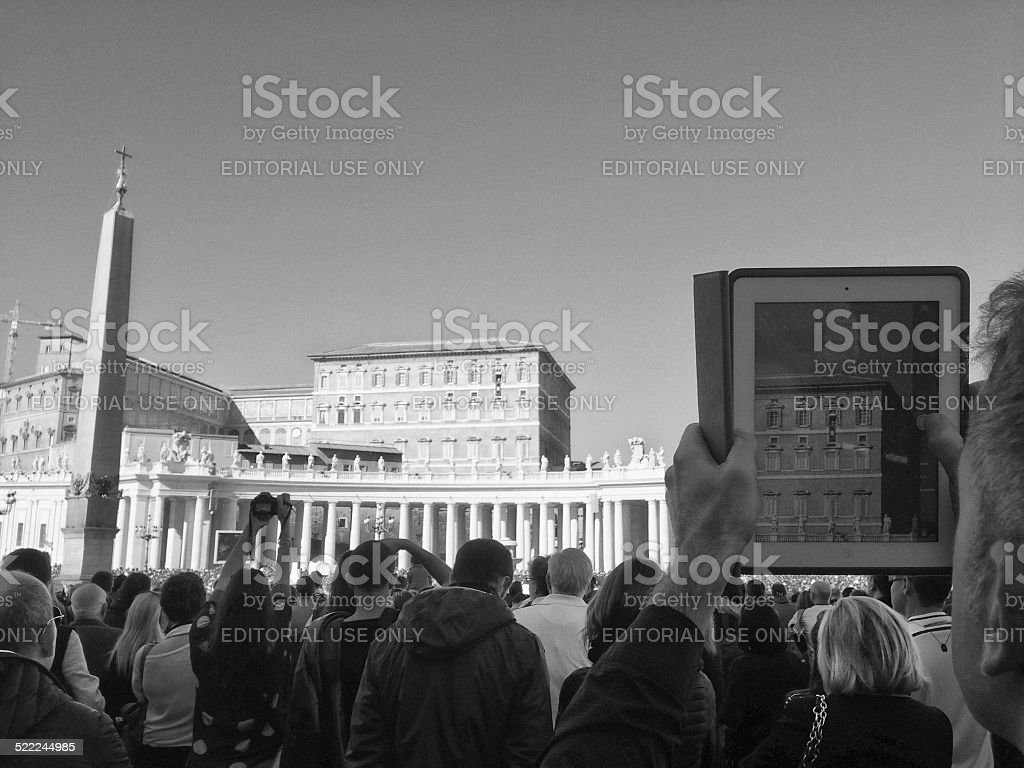 The Pope speaks while people film him with tablets stock photo