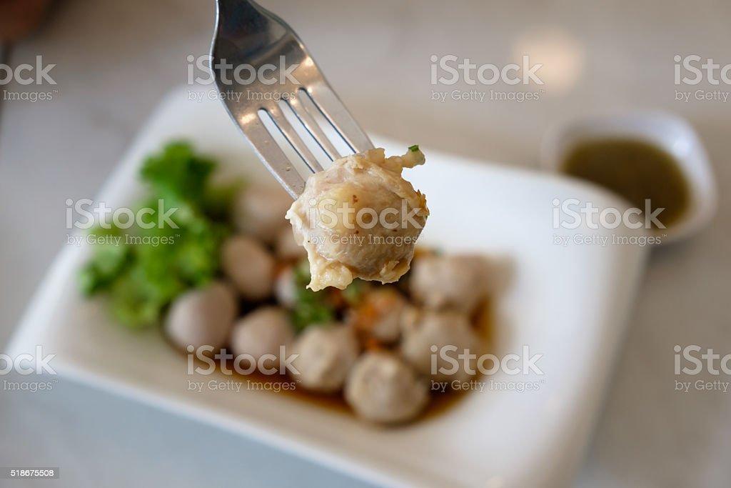 The pork ball on fork in Thai restaurant. stock photo