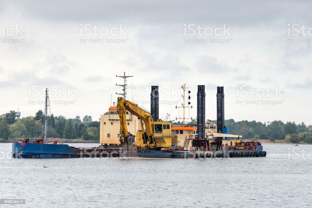 The port channel riverbed cleaning work. stock photo