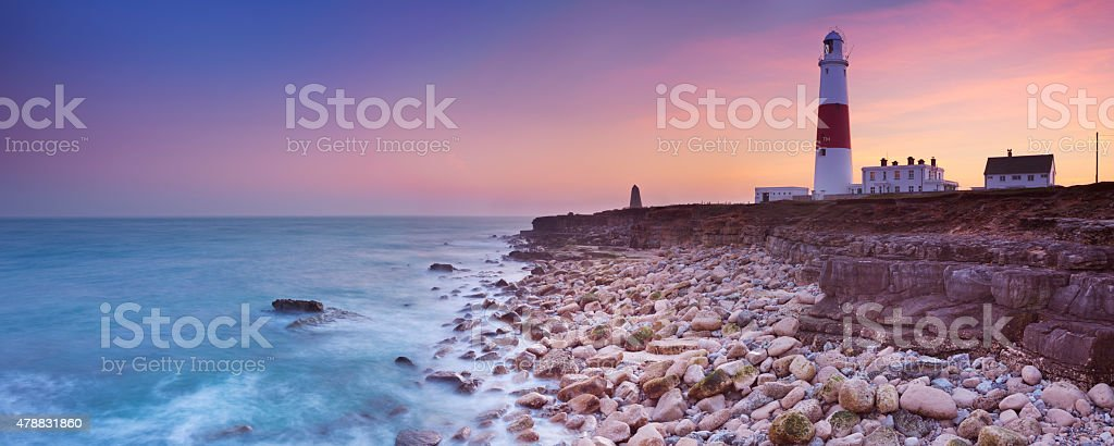 The Portland Bill Lighthouse in Dorset, England at sunset stock photo