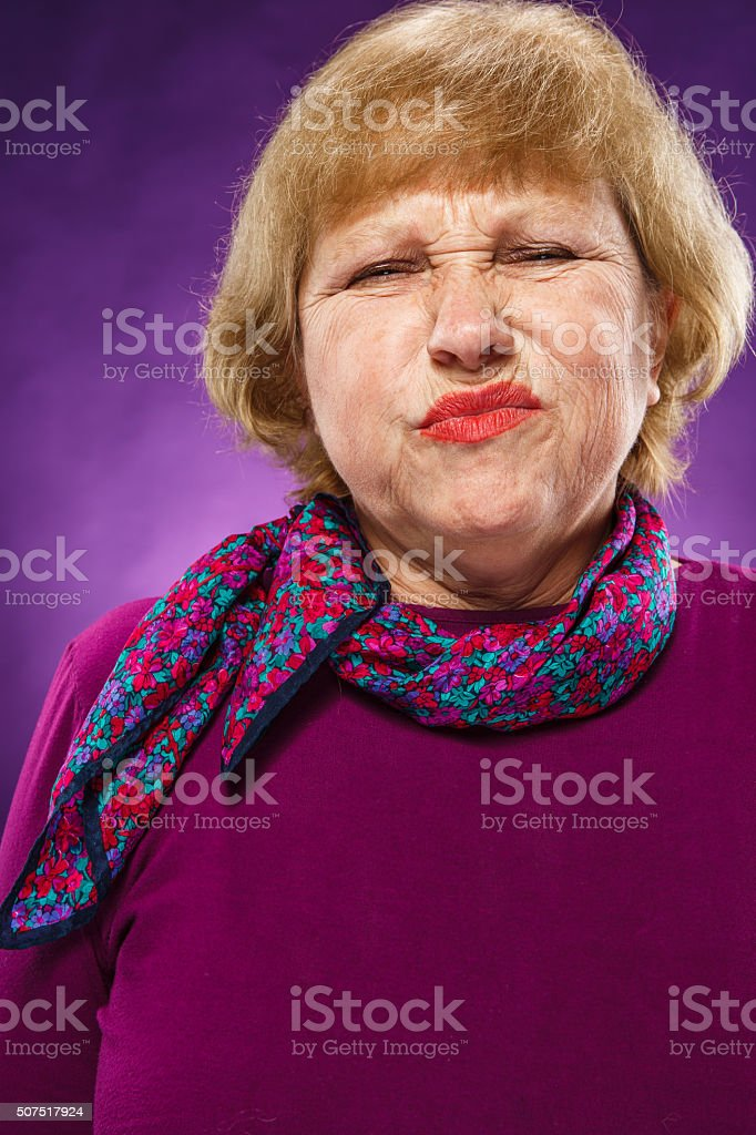 The portrait of a disaffected senior woman stock photo