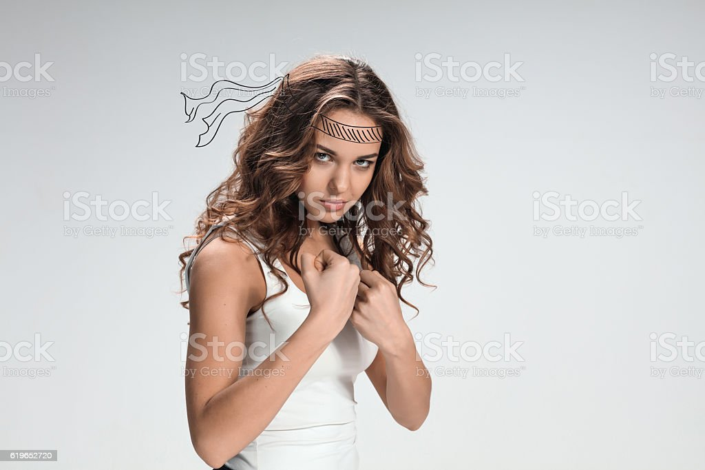 The portrait of violent and militant woman stock photo