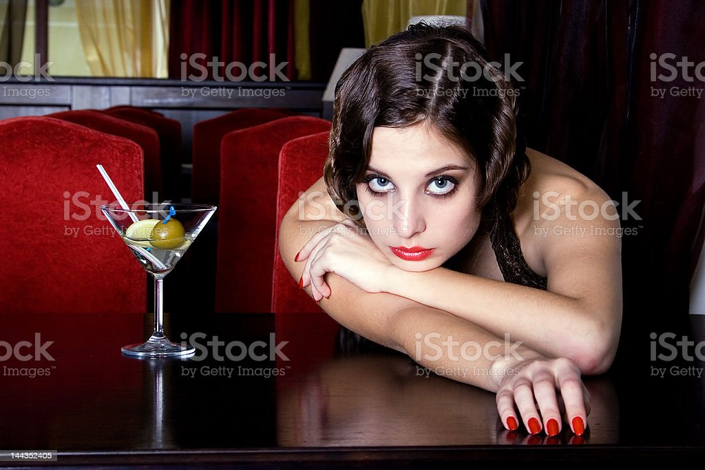 The posing girl at restaurant in style old-fashioned royalty-free stock photo