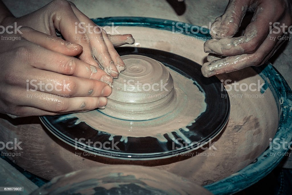 The potter molds a jug on the circle stock photo