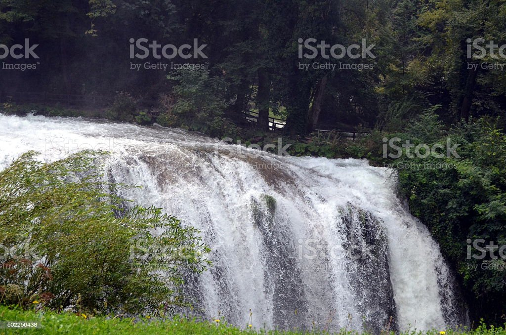 the power of the waterfall in the middle of nature stock photo