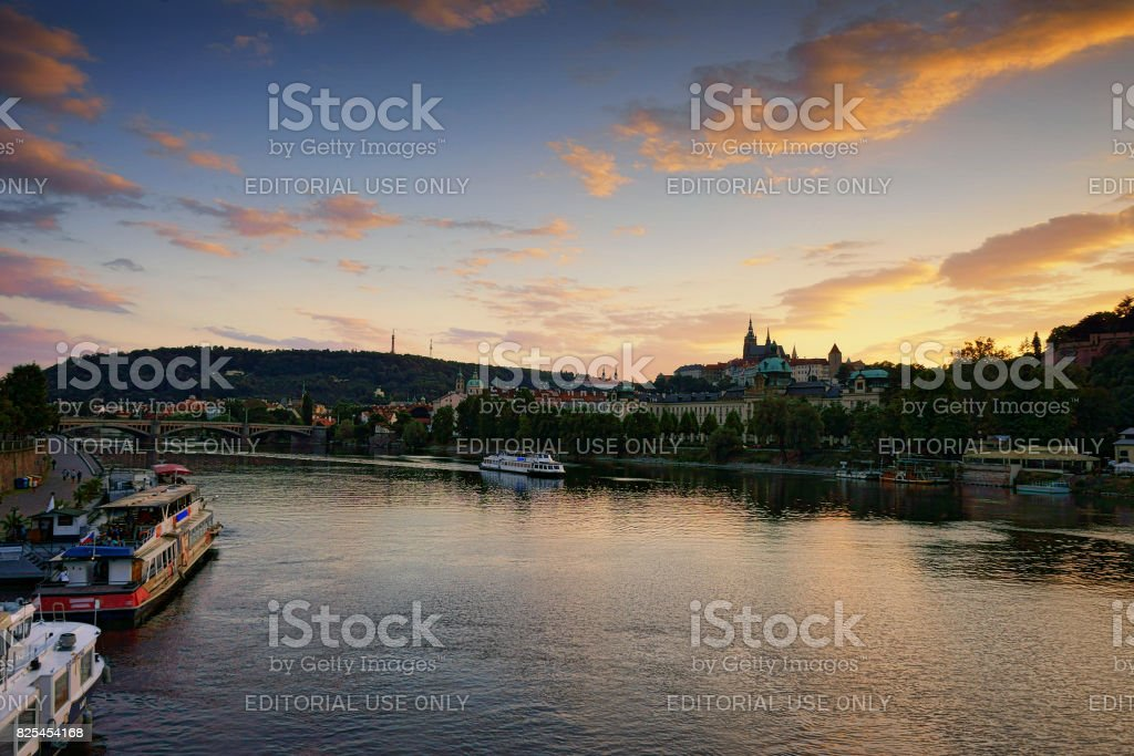 The Prague castle and St. Vitus Cathedral during sunset stock photo