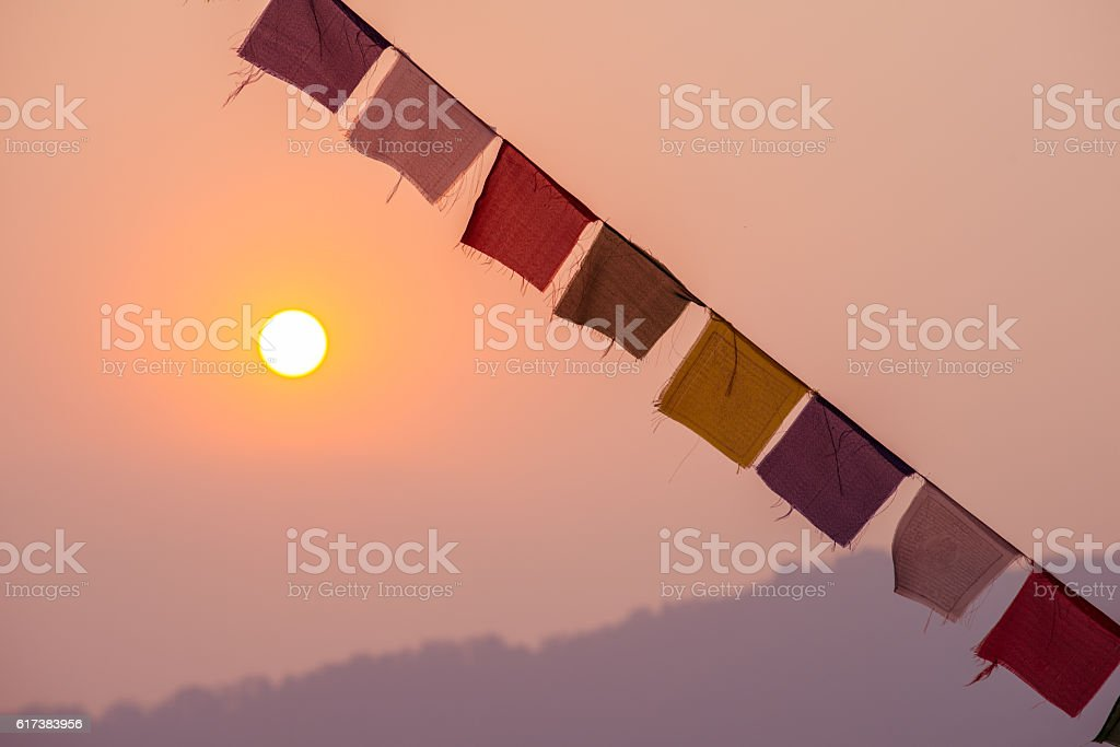 The prayer flags and sunrise in Nepal. stock photo