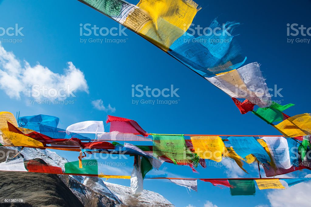 The prayer flags fluttering in the Himalayas, Tibet stock photo
