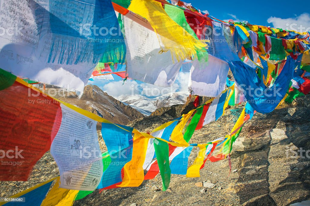 The prayer flags fluttering in the mountains, Tibet stock photo