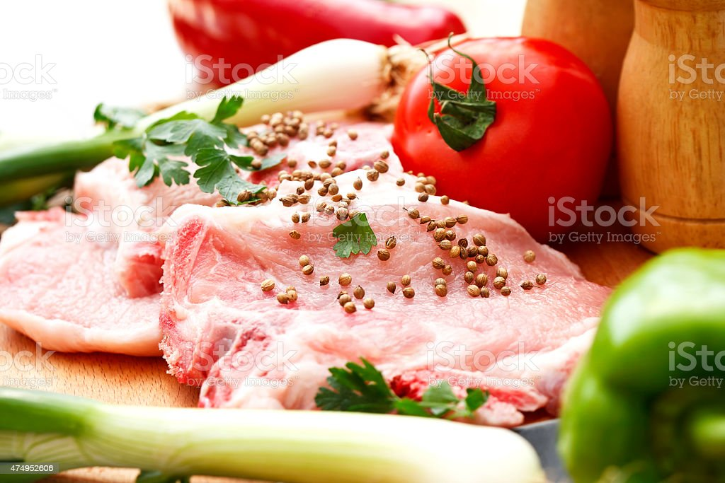 the preparation of meat and vegetables for a meal stock photo