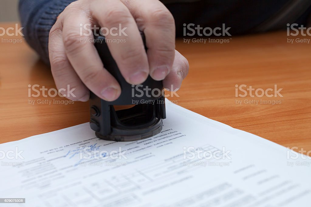 The press on the document stock photo