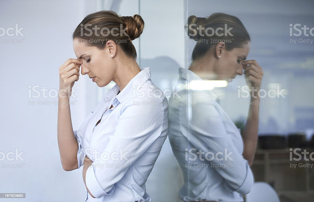 The pressure of work is getting to her stock photo