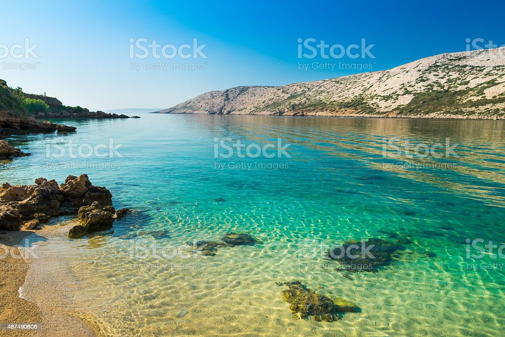 The pristine coastline and crystal clear water . stock photo