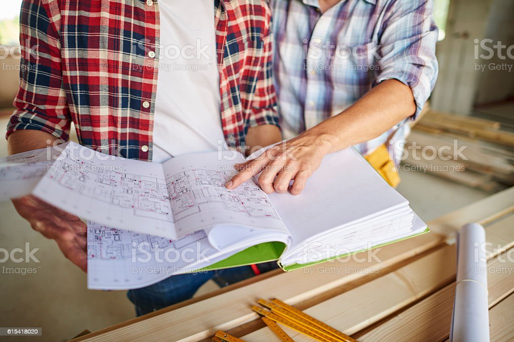 The problem has been resolved by two workers stock photo