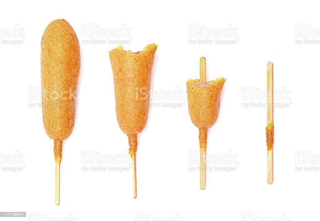 The Process of A Corn Dog Being Eaten stock photo