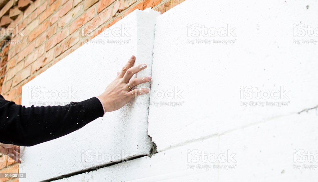 The process of attaching the white foam stock photo