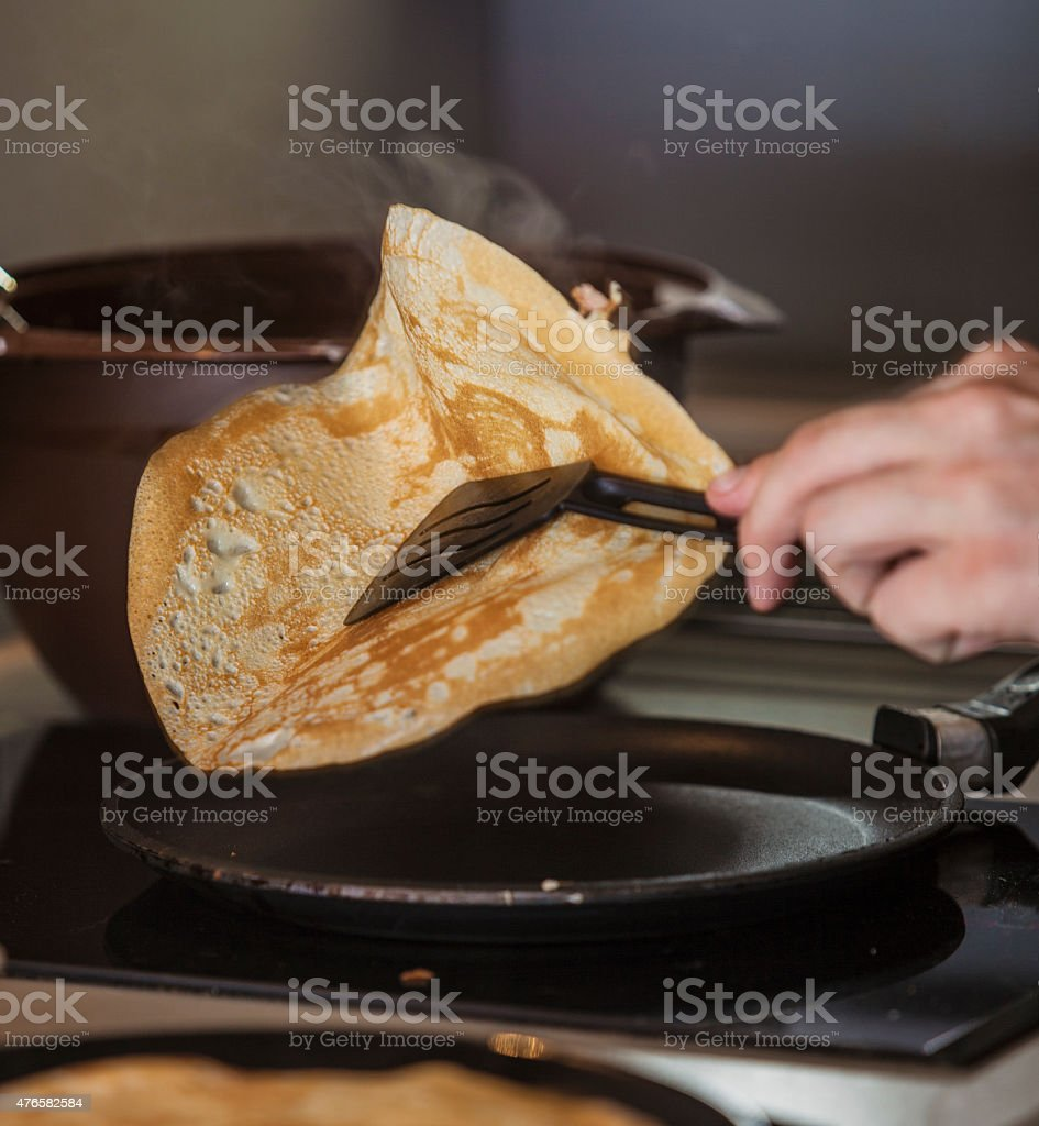 The process of cooking pancakes on a skillet stock photo