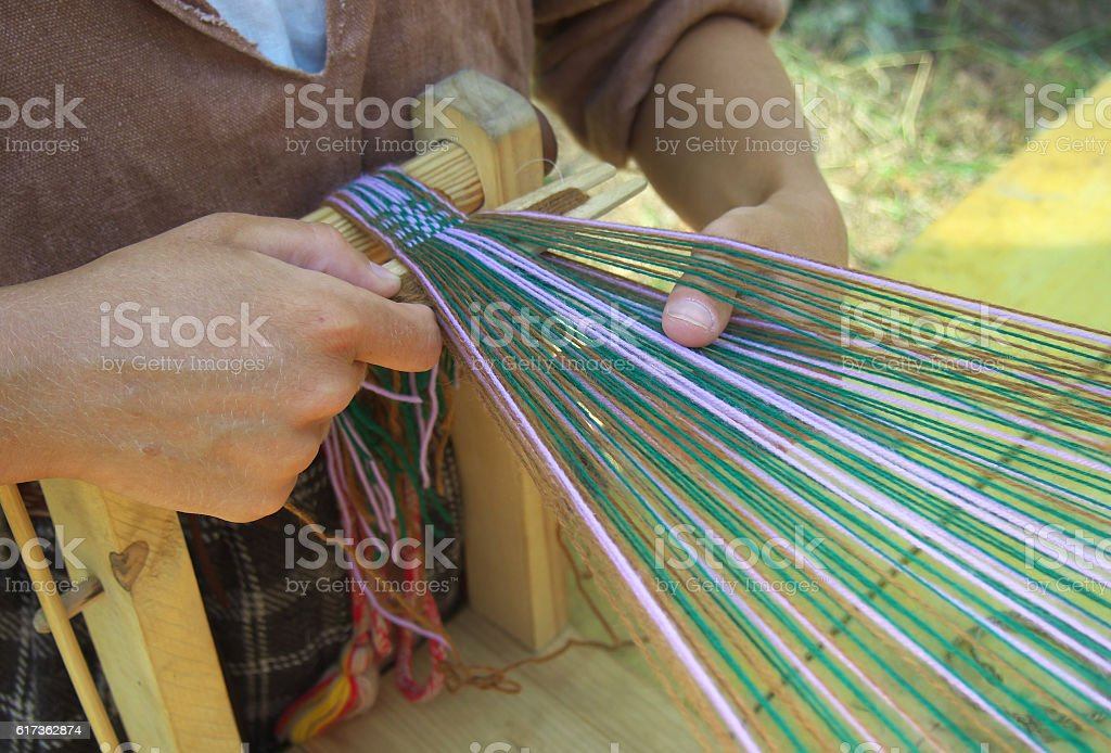 The process of making woven belt of linen yarn stock photo