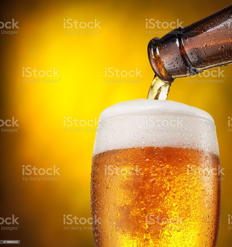 The process of pouring beer into the glass. stock photo