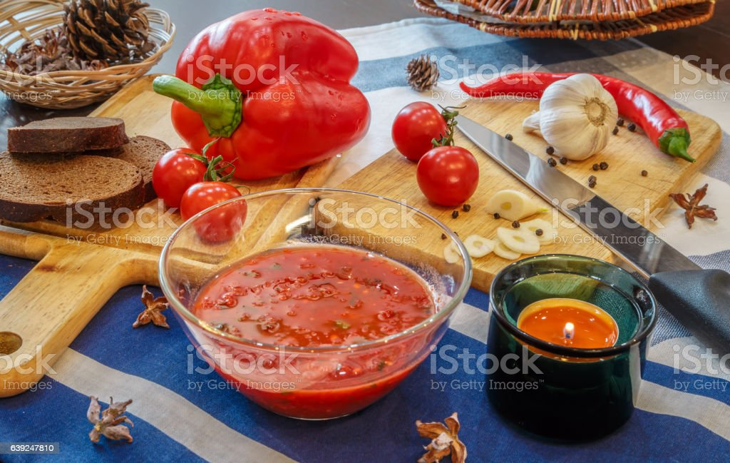 The process of preparing tomato sauce adjika stock photo