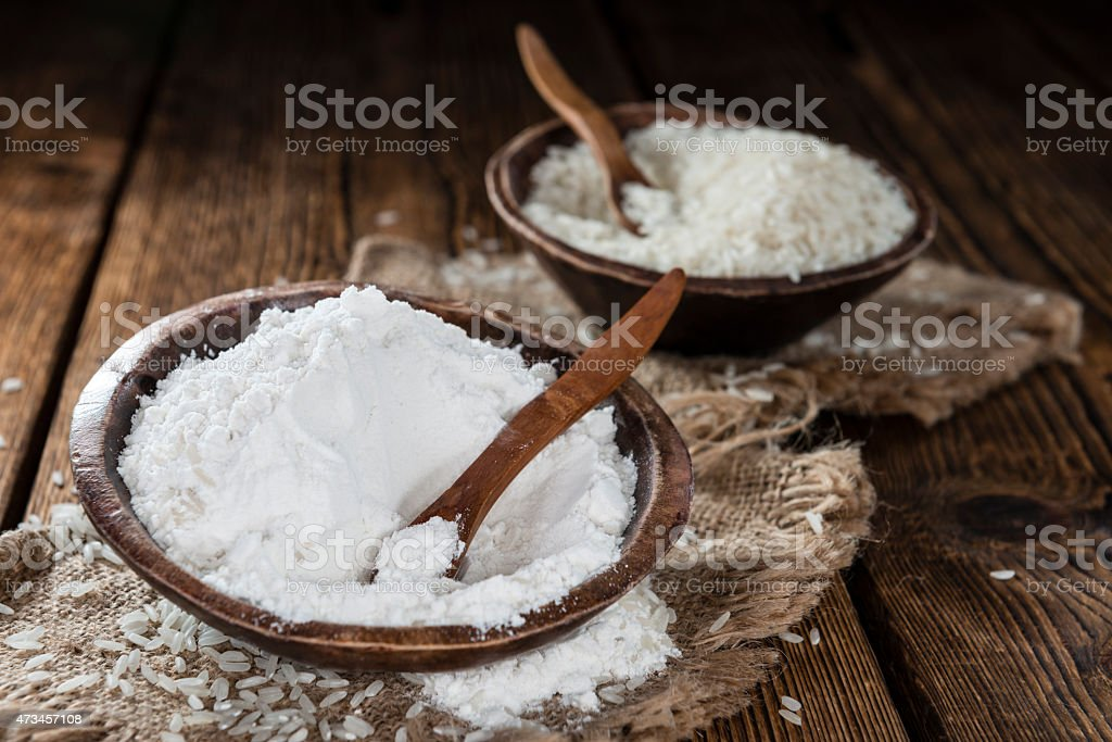 The process of rice grains becoming rice flour stock photo
