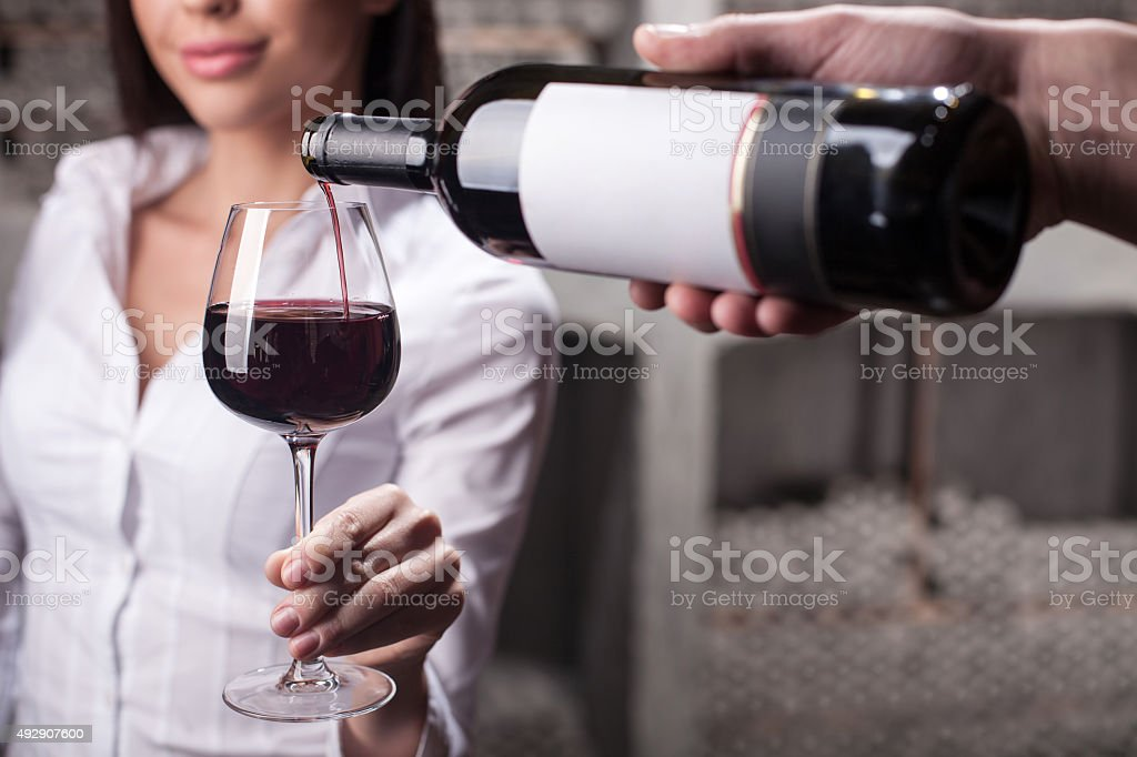 The process of tasting drink in liquor store stock photo