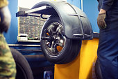 The process tire service, tyre wheel car in motion