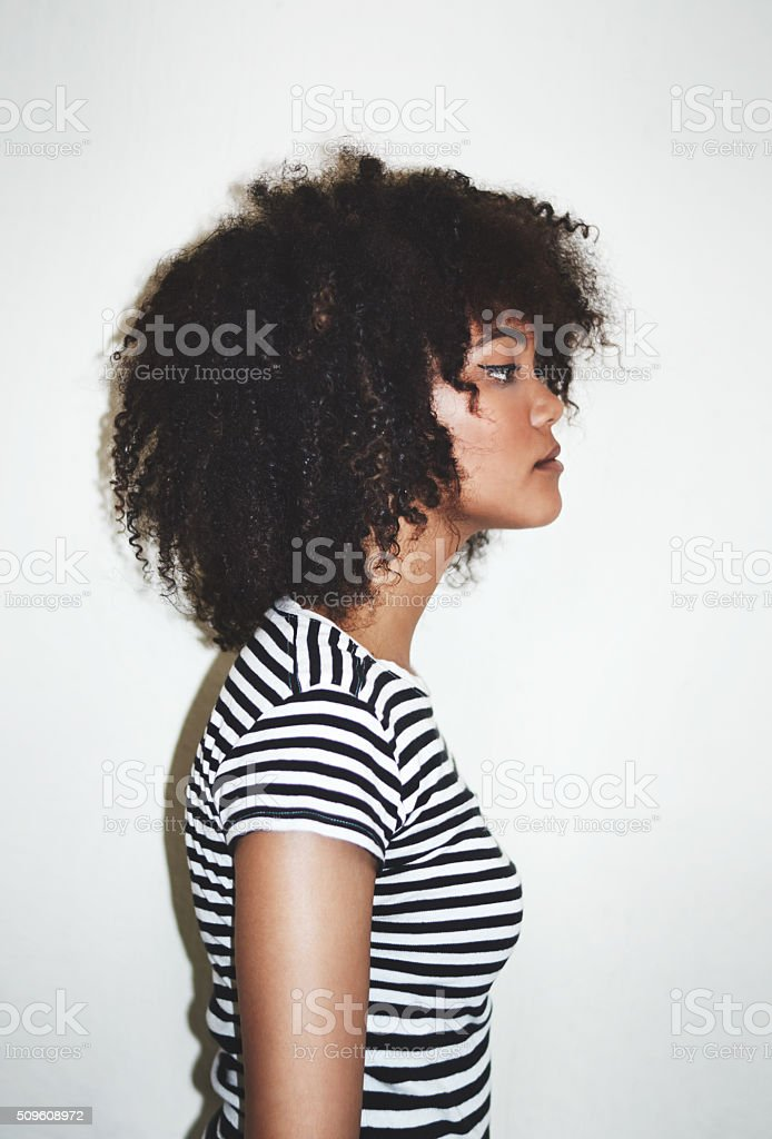 The profile of curly perfection stock photo