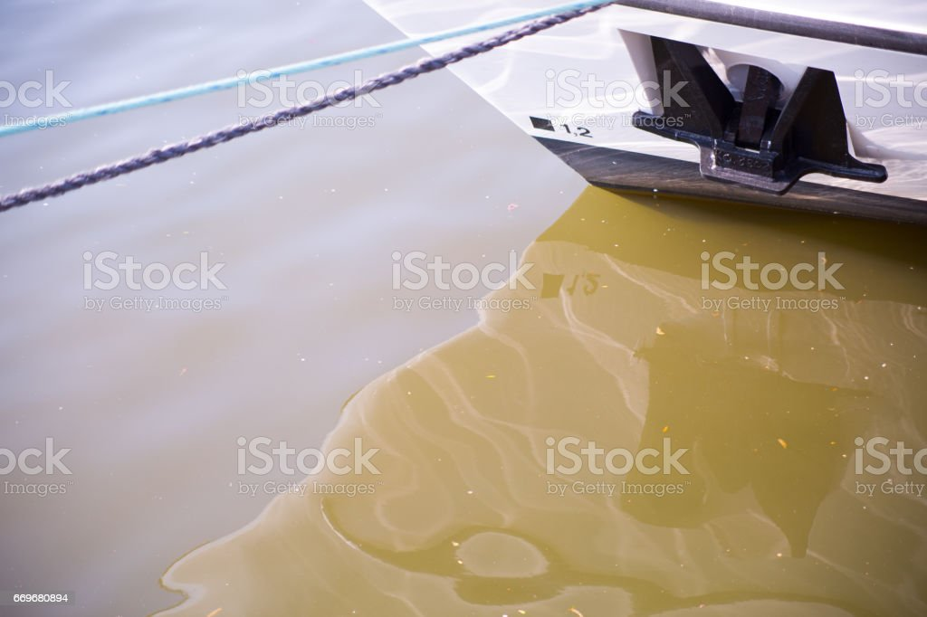 The prow of a ship anchor hanging. stock photo