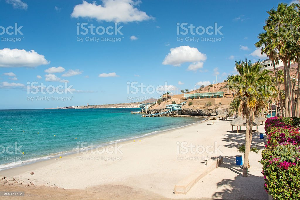 The public beach with water slide in La Paz , Mexico. stock photo
