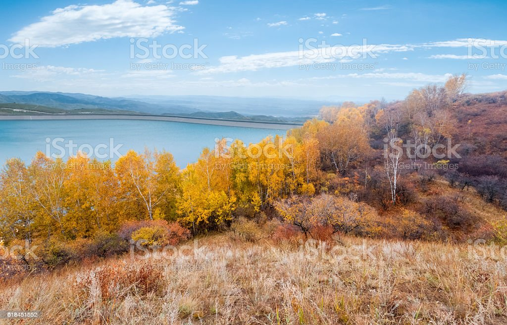 the pumped-storage power station reservoir in autumn stock photo