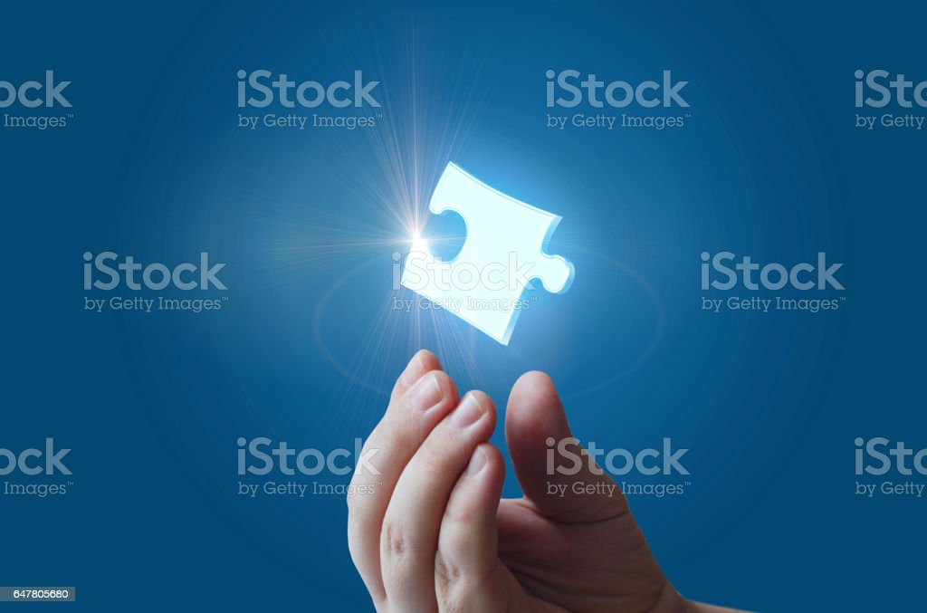 The puzzle is in the hand of businessman. vector art illustration