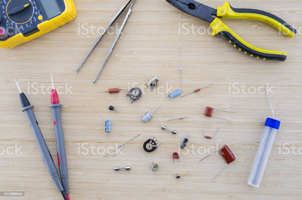 The radio parts and tools on the wooden table. stock photo